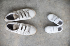 Daddy`s sneakers and babys sneakers Stock Photo