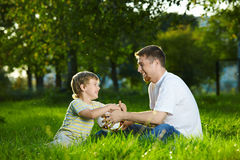 Daddy and son at a ball Stock Images