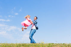 Daddy spinning around his daughter Stock Image