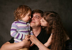 Daddy and two daughters Stock Photos