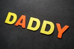 Daddy. Word colorful letter text on black and grey background illustration creative type graphic message expression pedro jose pedryj royalty free stock photo