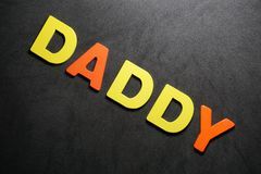 Daddy. Word colorful letter text on black and grey background illustration creative type graphic message expression pedro jose pedryj royalty free stock images