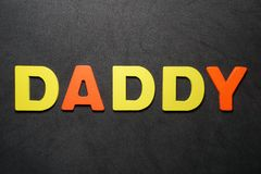 Daddy. Word colorful letter text on black and grey background illustration creative type graphic message expression pedro jose pedryj stock photo