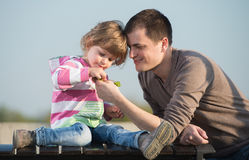 Daddy and young daughter Royalty Free Stock Image