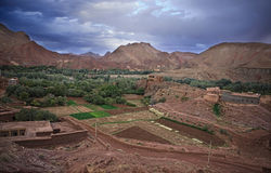 Dades valley farms. The strength of the colours will never escape your memory, red, green and white. Boumalne du Dades, the mountain closes up on both sides of Royalty Free Stock Photo