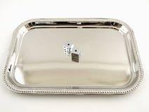 Dadi d'argento su un cassetto d'argento Fotografia Stock Libera da Diritti