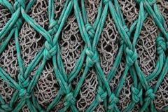 Dadi di un fishingnet commerciale Immagini Stock