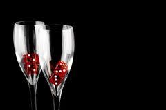 Dadi rossi in un vetro del champagne Fotografia Stock Libera da Diritti