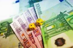Dadi su migliaia di euro Immagine Stock
