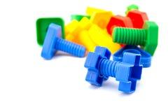 Dadi variopinti e divertenti - e - giocattoli dei bulloni Immagini Stock