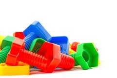 Dadi variopinti e divertenti - e - giocattoli dei bulloni isolati Immagine Stock Libera da Diritti