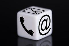 Dados blancos con los iconos del correo y del teléfono Imagenes de archivo