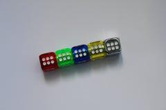 Dados coloridos na mesa Imagens de Stock