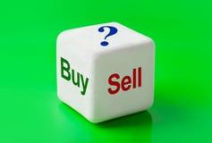 Dados con la compra y la venta de las palabras Fotografía de archivo libre de regalías