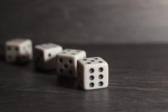 Dados do objeto do jogo isolados em um fundo branco Foto de Stock