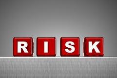 Dados que deletrean el riesgo de la palabra Imagen de archivo libre de regalías
