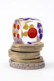 Dados y monedas Imagenes de archivo