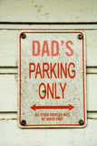Dads Parking Only. Sign on a random garagedoor in a random street saying Dads parking only. I found that very funny Royalty Free Stock Image
