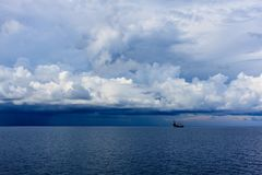 Daek blue sea color and storm raining cloud with drilling rig b stock photos
