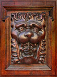 The daemon face - medieval wood carving Stock Photo