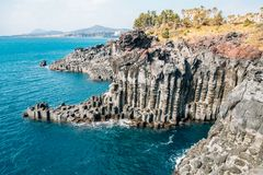 Daepo Jusangjeolli Cliff Columnar Joints and sea in Jeju Island, Korea. Daepo Jusangjeolli Cliff Columnar Joints and sea at Jeju Island, Korea royalty free stock images