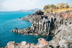 Daepo Jusangjeolli Cliff Columnar Joints and sea in Jeju Island, Korea. Daepo Jusangjeolli Cliff Columnar Joints and sea at Jeju Island, Korea royalty free stock image