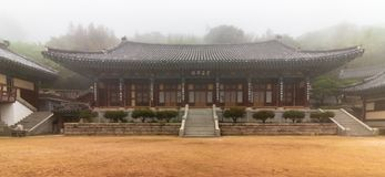 Inside panorama of Korean Buddhistic Temple Daeseongam, Great Saint Hermitage, near Beomeosa on a foggy day. Located in Geumjeong royalty free stock photos