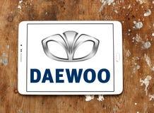 Daewoo car logo. Logo of daewoo car brand on samsung tablet on wooden background royalty free stock image