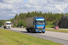 DAF Semi Trucks Transport Merchandise among Traffic Stock Photos