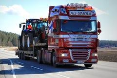 DAF XF Hauls Farm Tractors along Road at Spring Royalty Free Stock Image
