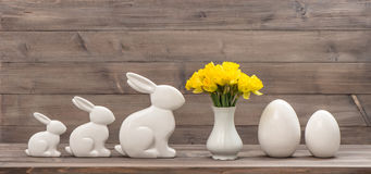 Daffodil flowers Easter bunny eggs Vintage decoration Stock Photos