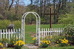 Daffodils, arbor and cross. Next to church, Valatie New York Stock Photography