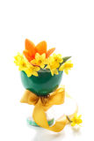 Daffodils. Bouquet of yellow daffodils with tulips in green vase Stock Photo