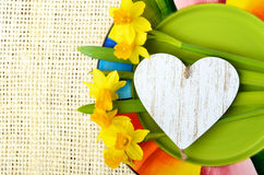 Daffodils and decorative heart. Stock Image