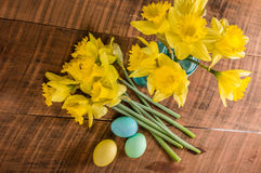 Daffodils and dyed Easter eggs Stock Photos