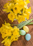 Daffodils and dyed Easter eggs Royalty Free Stock Photo