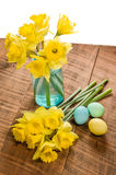 Daffodils and dyed Easter eggs Stock Photo