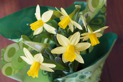 Daffodils for an Easter Celebration. Daffodils in a green wrapping placed on a table Stock Photography