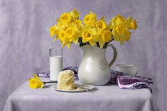 Daffodils, milk and cake Royalty Free Stock Image