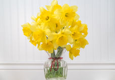 Daffodils in a vase in rustic setting - horizontal Stock Images