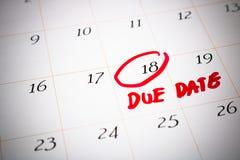 Dag för förfallet datum, 18th, röd cirklad fläck på en vit kalender, som Royaltyfri Bild