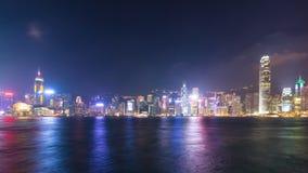 Dag för Tid schackningsperiod till den victoria för nattHong Kong cityscape hamnen och symfonin av ljus arkivfilmer