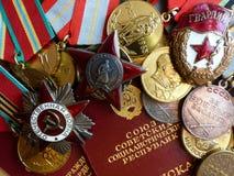 dag 9 kan segern Beställning av den röda stjärna`en för `, ` den stora patriotiska krig`en, ett tecken av ` bevakar ` och medalje Arkivbilder