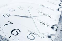Dagar och klocka arkivfoton
