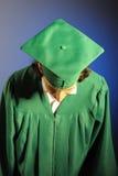dagavläggande av examen hans lyckade manstående Arkivfoton