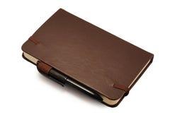 Dagbok med den isolerade pennan Royaltyfria Foton