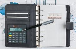 Dagbok, räknemaskin och penna Royaltyfri Fotografi