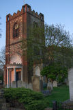 Dagenham Parish Church. The Parish Church of Dagenham, Essex, England in the evening sunshine, surrounded by its ancient and fascinating graveyard Stock Photos