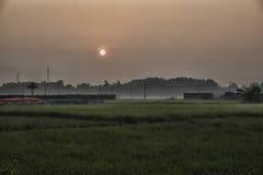 Dageraad bij platteland Stock Afbeelding