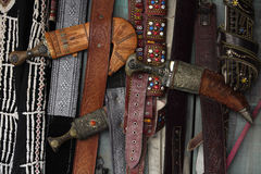 Daggers and belts Stock Photography